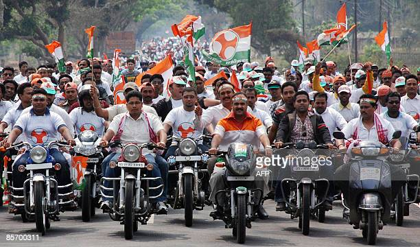 Congress party supporters participate in a motorcycle rally in Boko Village in Kamrup district some 50 kilometres from Guwahati the capital city of...