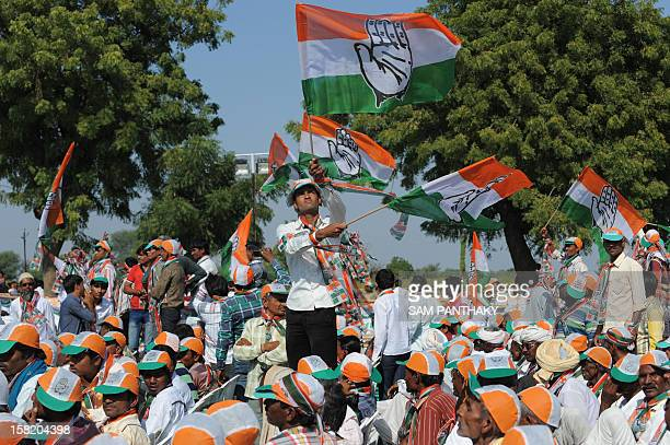 Congress Party supporters wave their party flags during a Congress rally addressed by general secretary Rahul Gandhi ahead of the Gujarat Assembly...