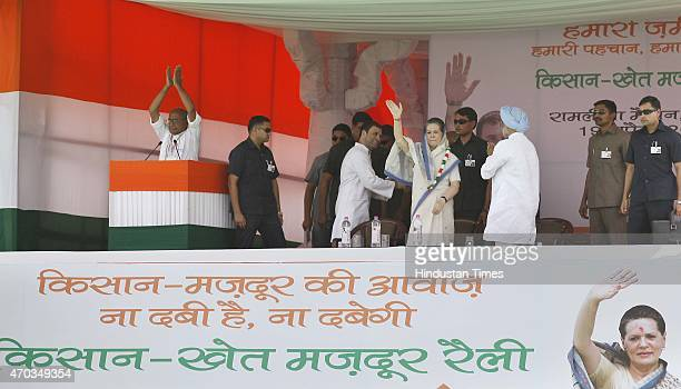 Congress Party vicepresident Rahul Gandhi and Congress President Sonia Gandhi wave to crowd during the farmers rally to galvanise protests against...