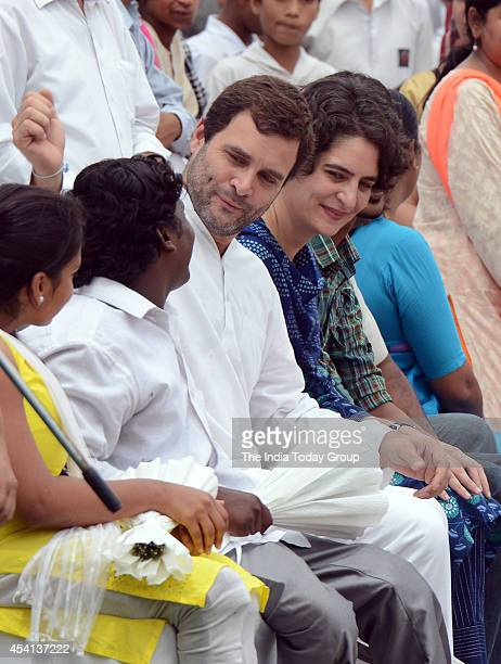 Congress Party VicePresident Rahul Gandhi with his sister Priyanka Vadra at a charity event to distribute threewheel scooters to disabled persons in...