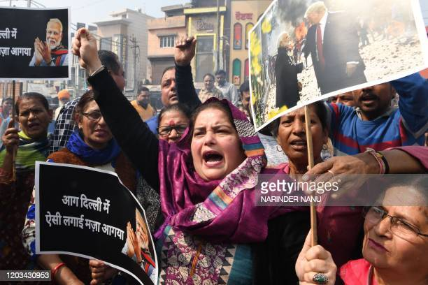 Congress Party workers shout slogans against Indian Prime Minister Narendra Modi during a protest in Amritsar on February 26 following clashes...