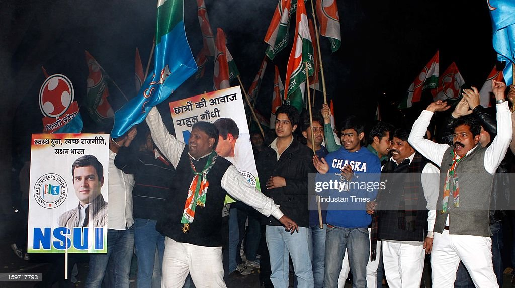 Congress Party youth wing NSUI supporters celebrate outside the AICC after announcement of Rahul Gandhi being made vice-president of Party at Chintan Shivir on January 19, 2013 in New Delhi, India.