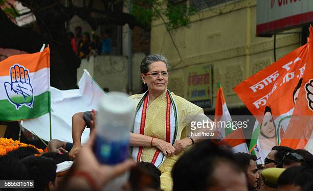 Congress Party's leader and president Sonia gandhi looks on towards supporters and local residents during her Road show in Varanasi on August...
