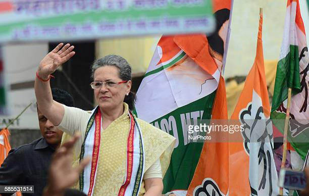 Congress Party's leader and president Sonia Gandhi waves hands towards supporters and local residents during her Road show in Varanasi on August...