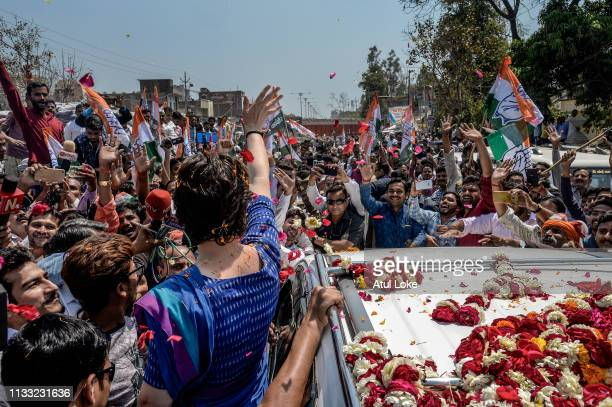 Congress Party's Priyanka Gandhi's waves to the crowd during her campaigns on March 27 in Uttar Pradesh, India. Congress leader Priyanka Gandhi...