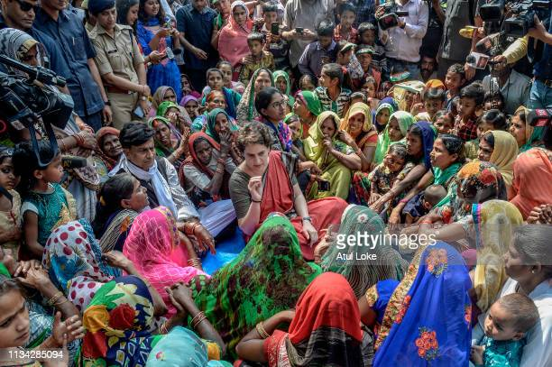 Congress Party's Priyanka Gandhispeaks with women froma village during her campaign for India National Congress on March 29, 2019 in Utter Pradesh,...