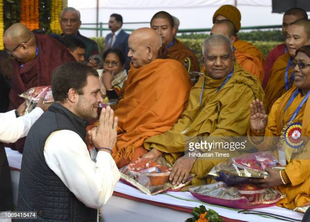 Congress President Rahul Gandhi greets Buddhist monks at a ceremony to pay homage to Bhimrao Ramji Ambedkar on the occasion of Mahaparinirvan Diwas'...