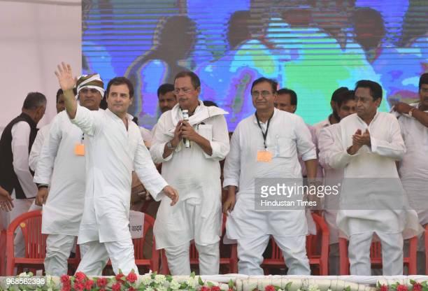 Congress president Rahul Gandhi waves at supporters as Arun Yadav Deepak Bavaria Kamal Nath looks on during 'Kisan Samriddhi Sankalp' rally in...