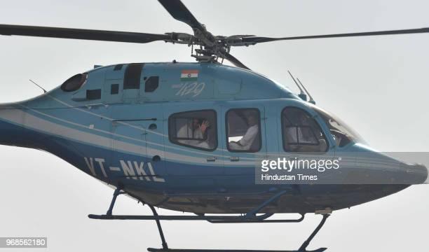 Congress president Rahul Gandhi waves from helicopter after addressing 'Kisan Samriddhi Sankalp' rally in Pipliya Mandi at Khokhra on June 6 2018 in...
