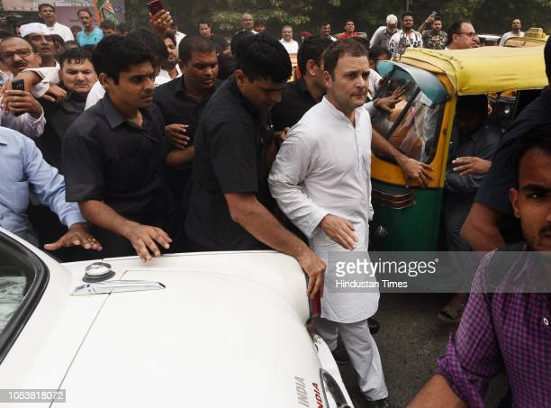 Congress president Rahul Gandhi with his supporters during the protest march at the CBI Headquarter demanding the reinstatement of CBI Director Alok...
