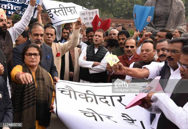 Congress President Rahul Gandhi with party leaders during a protest over the Rafale deal at last day of Parliament Budget Session near Mahatma...