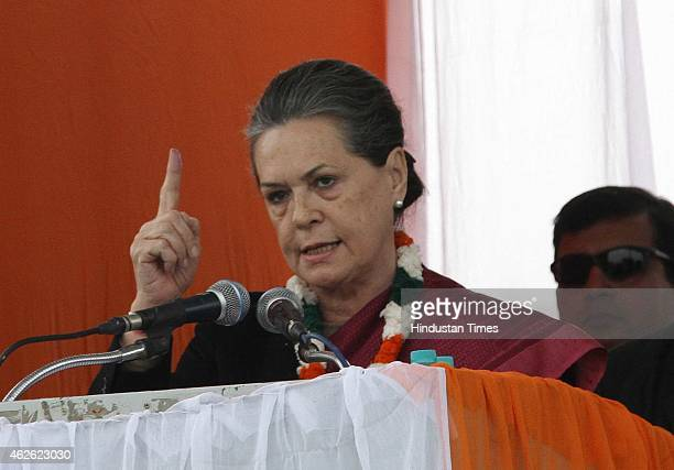 Congress President Sonia Gandhi addresses during an election rally at Meethapur near Badarpur on February 1, 2015 in New Delhi, India. Sonia Gandhi...
