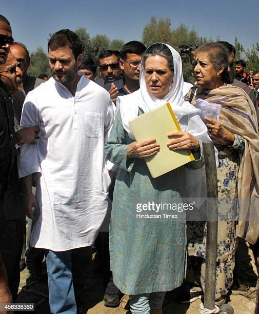 Congress president Sonia Gandhi along with party vice president Rahul Gandhi interact with flood victims on September 29 2014 in south Kashmir...