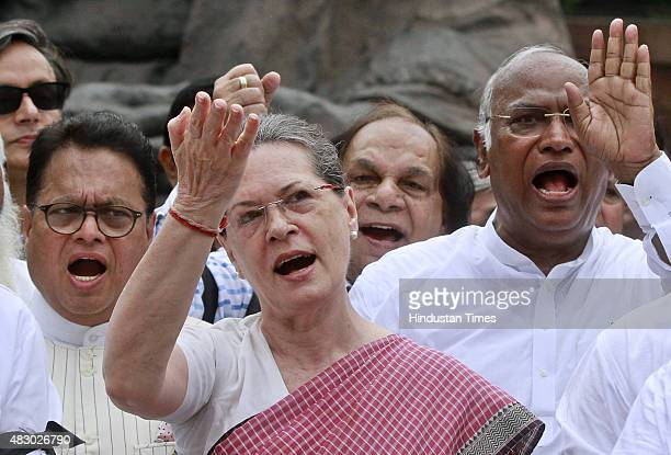 Congress President Sonia Gandhi and other leaders during a protest against the suspension of 25 party members, at Parliament, on August 5, 2015 in...