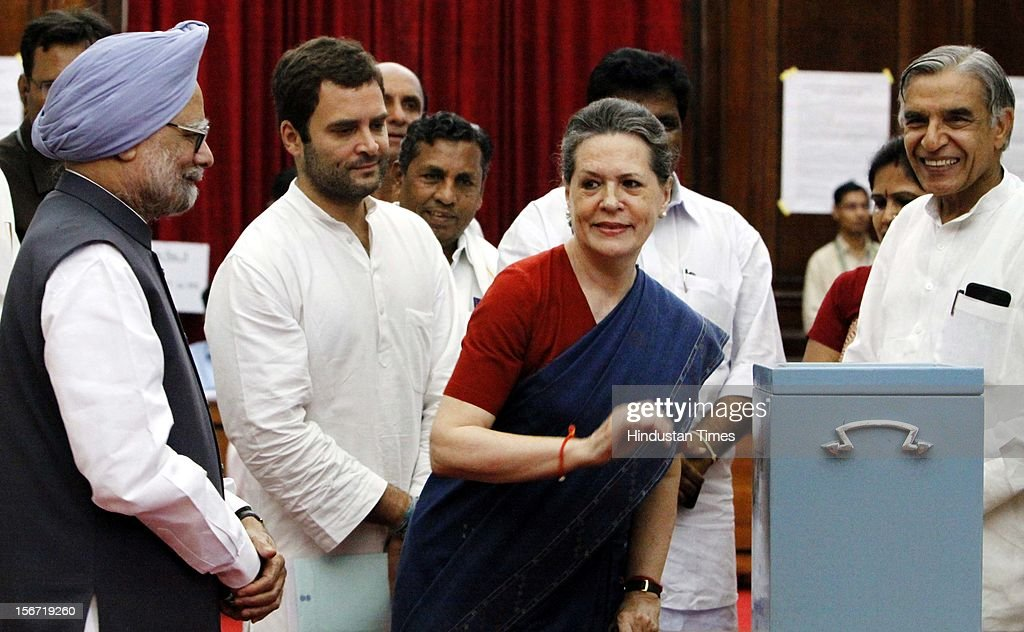 'NEW DELHI, INDIA - AUGUST 7: Congress President Sonia Gandhi casting vote for the election of Vice President as Prime Minister Manmohan Singh and Congress MP Rahul Gandhi looks on at Parliament house on August 7, 2012 in New Delhi, India. (Photo by Sunil Saxena/Hindustan Times via Getty Images)'