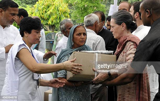 Congress president Sonia Gandhi distributing relief material to flood victims of Jammu and Kashmir floods on September 30 2014 in Jammu India On a...