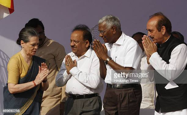 Congress President Sonia Gandhi exchanges greetings with Union Minister Harshvardhan CPI leader D Raja and Congress leader Ghulam Nabi Azad at a...