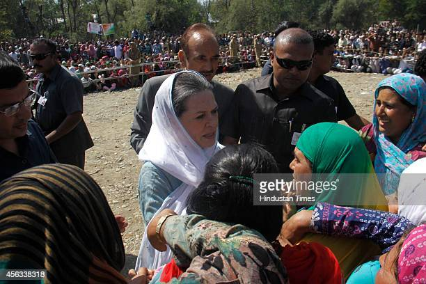 Congress president Sonia Gandhi interacts with flood victims on September 29 2014 in south Kashmir Anantnag district some 90 kms from Srinagar India...