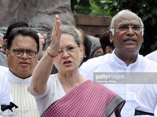 Congress President Sonia Gandhi joins other Congress Party members to shout slogans against Prime Minister Narendra Modi and the NDA government at...