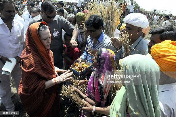Congress President Sonia Gandhi meeting with farmers of Madavda village at Neemuch district whose crops were damaged in unseasonal rains and...
