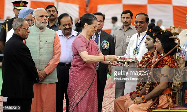Congress President Sonia Gandhi performs Aarti of artists enacting Lord Ram and Laxman with Prime Minister Narendra Modi President Pranab Mukherjee...