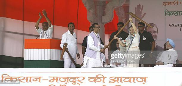 Congress president Sonia Gandhi receives a plough from party leader Ajay Maken during the farmers rally to galvanise protests against National...
