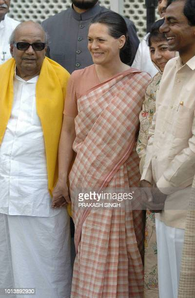 Congress President Sonia Gandhi smiles as she poses with India's Dravida Munntra Kazhagam Party's President MKarunanidhi before a meeting with...