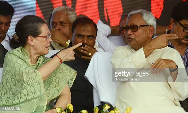 Congress President Sonia Gandhi with Bihar Chief Minister Nitish Kumar during the Swabhiman rally at Gandhi Maidan on August 30 2015 in Patna India...