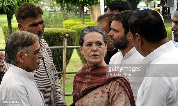 Congress president Sonia Gandhi with her son Rahul Gandhi meeting with flood victims of Jammu and Kashmir floods on September 30 2014 in Jammu India...