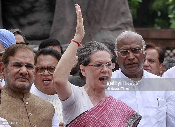 Congress President Sonia Gandhi with JD leader Sharad Yadav and other leaders during a protest against the suspension of 25 party members, at...