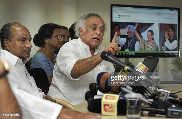 Congress senior leader Jairam Ramesh with former Defence Minister A K Antony talking with media persons after launching the Zameenwapsicom website...