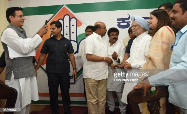 Congress spokesperson Randeep Surjewala takes photo of the Former Prime Minister of India Manmohan Singh with AICC national Convenor Priyanka...