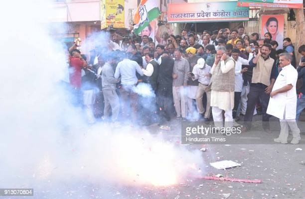 Congress supporters along with president Sachin Pilot celebrate the win of party candidates in two Lok Sabha and one Assembly bypoll elections at...