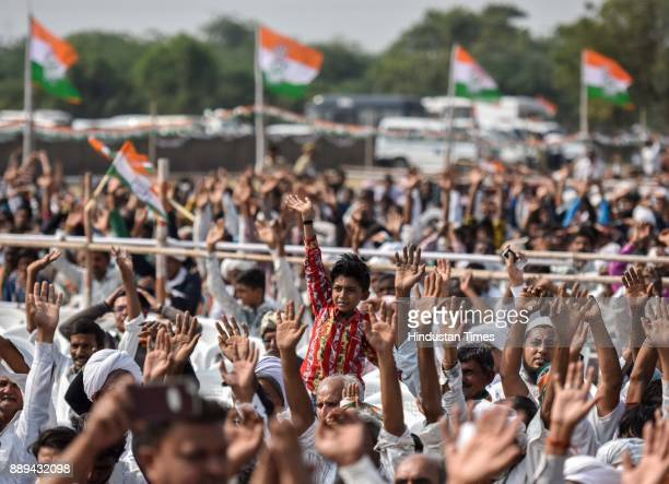 Congress supporters and workers during an election campaign rally for State Assembly Election by Congress Vice President Rahul Gandhi at Patan on...