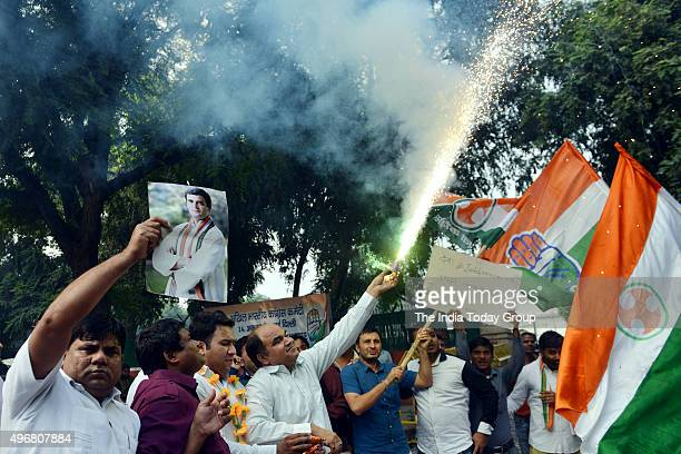 Congress supporters celebrate at party's win in Bihar assembly elections outside party Office AICC in New Delhi