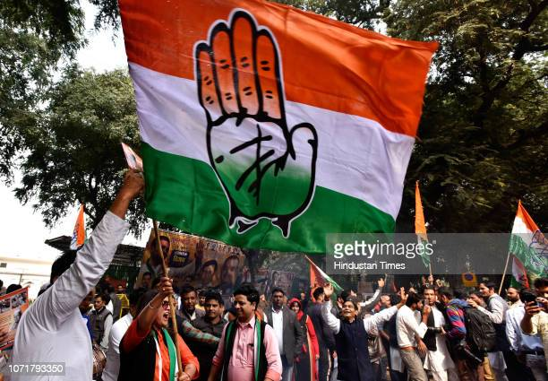 Congress supporters celebrate party's victory in assembly elections outside AICC HQ on December 11 2018 in New Delhi India Congress workers burst...