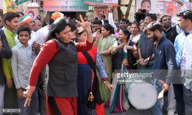 Congress supporters celebrates the win of party candidates in two Lok Sabha and one Assembly bypoll elections at State congress office on February 1...