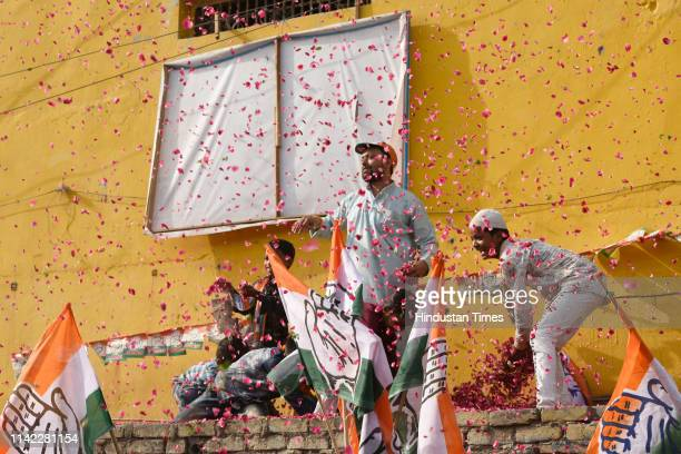 Congress supporters shower rose petals on party general secretary for eastern Uttar Pradesh Priyanka Gandhi Vadra as she campaigns for Congress...