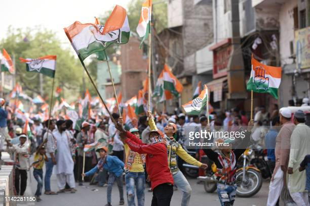Congress supporters wave party flags as party general secretary for eastern Uttar Pradesh Priyanka Gandhi Vadra campaigns for party candidate from...