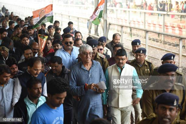 Congress supporters welcome former opposition leader of Chhattisgarh Assembly TS Singh Deo at Raipur Railway Station as he arrives after victory in...