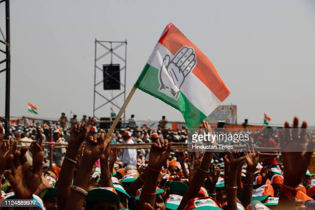Congress supporters with the party flags during Jan Akrosh Rally at Lal Dungri village of Valsad district on February 14 2019 in Valsad India...