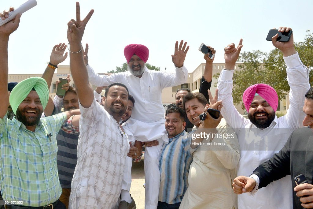 Congress supportes lifts Congress candidate Hardev Singh Laddi Sherowalia who won Shahkot bypoll on May 31 2018 in Jalandhar India