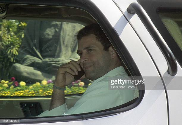 Congress Vice President and member of parliament Rahul Gandhi arrive on the car talking with mobile phone attending ongoing parliament budget session...