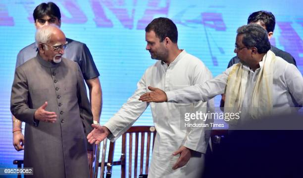 Congress Vice President Rahul Gandhi and Karnataka Chief Minister Siddaramaiah greet Vice President of India Hamid Ansari during the release of...