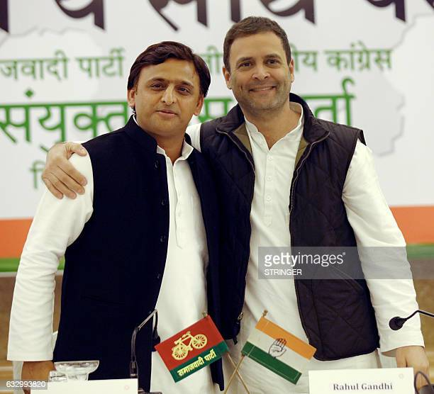 Congress vice president Rahul Gandhi and Uttar Pradesh Chief Minister and Samajwadi Party chief Akhilesh Yadav gesture during a joint press...