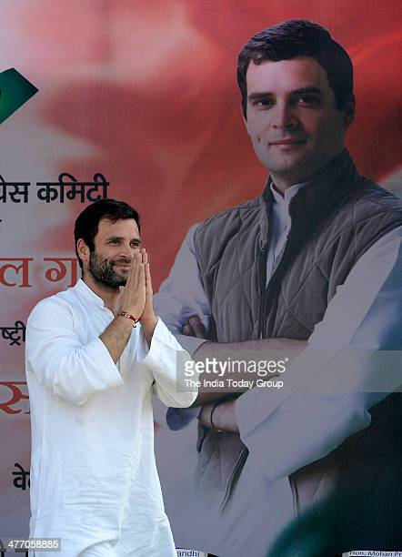 Congress vice president Rahul Gandhi greets his supporters during a poll rally in Bhiwandi in Thane district of Maharashtra on Thursday March 6 2014