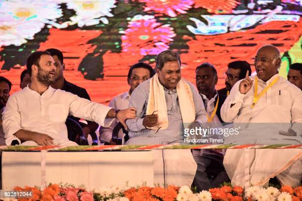 Congress Vice President Rahul Gandhi Karnataka Chief Minister Siddaramaiah and the leader of the opposition Lok Sabha Mallikarjun Kharge share a...