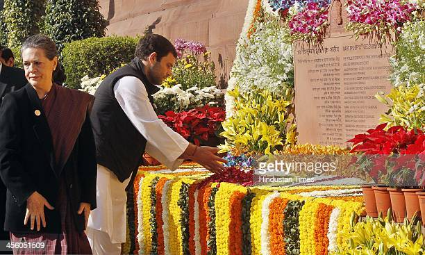 Congress Vice President Rahul Gandhi pays flower tribute to martyrs of Parliament attack on its 12th anniversary on December 13 2013 in New Delhi...