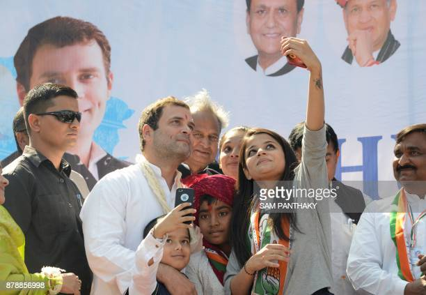 Congress Vice President Rahul Gandhi takes a selfie photograph photo with supporters at a rally in Dahegam some 40km from Ahmedabad on November 25...
