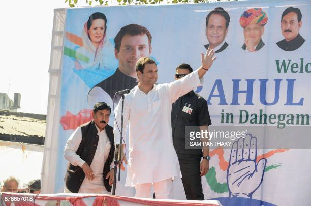 Congress Vice President Rahul Gandhi waves as he arrives to address a rally in Dahegam some 40km from Ahmedabad on November 25 2017 Voters in Indian...